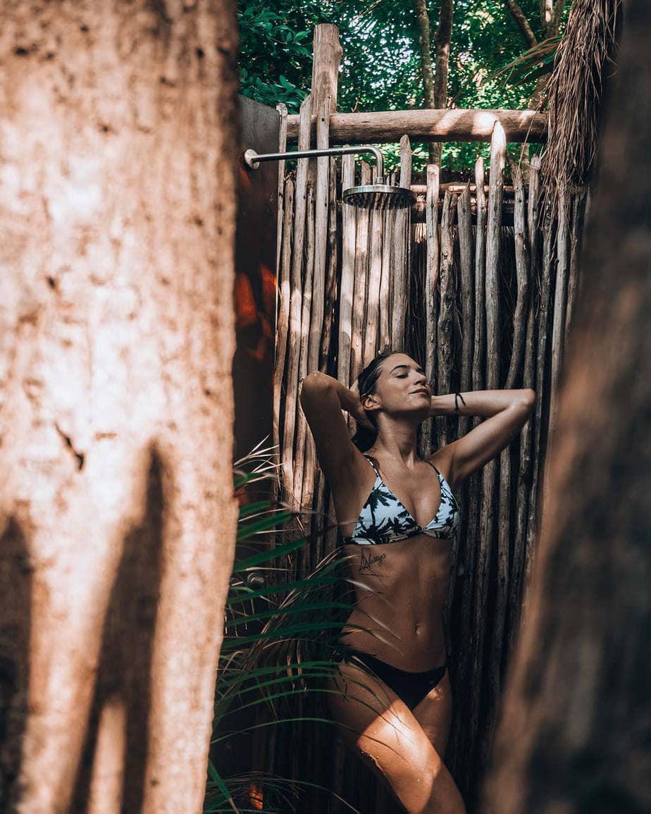 young woman taking shower scopio 5db7fbf2 7094 4c54 aab9 9dbbbfb6a856