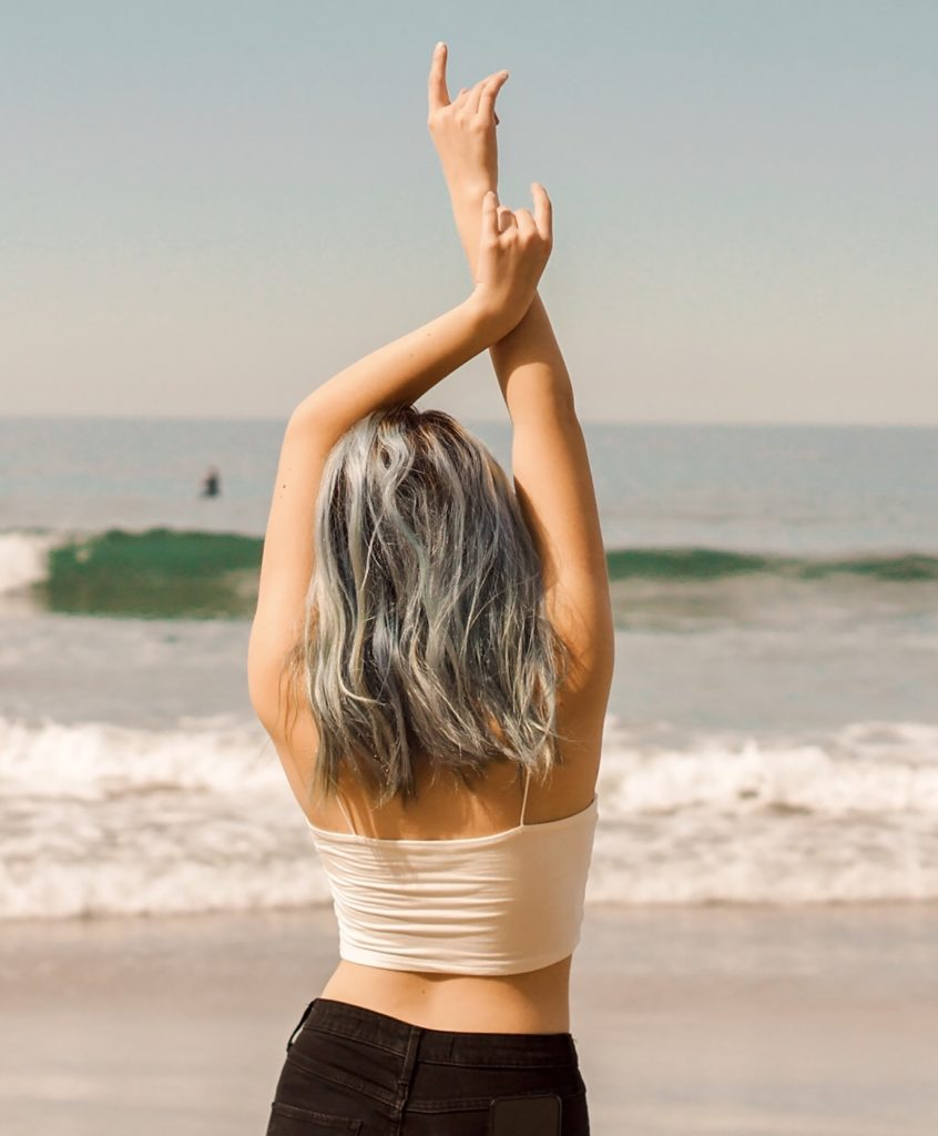 woman in white shirt and black skirt standing on beach scopio dc73fcb1 f402 4351 9f3f 8e58d486f36d Copy